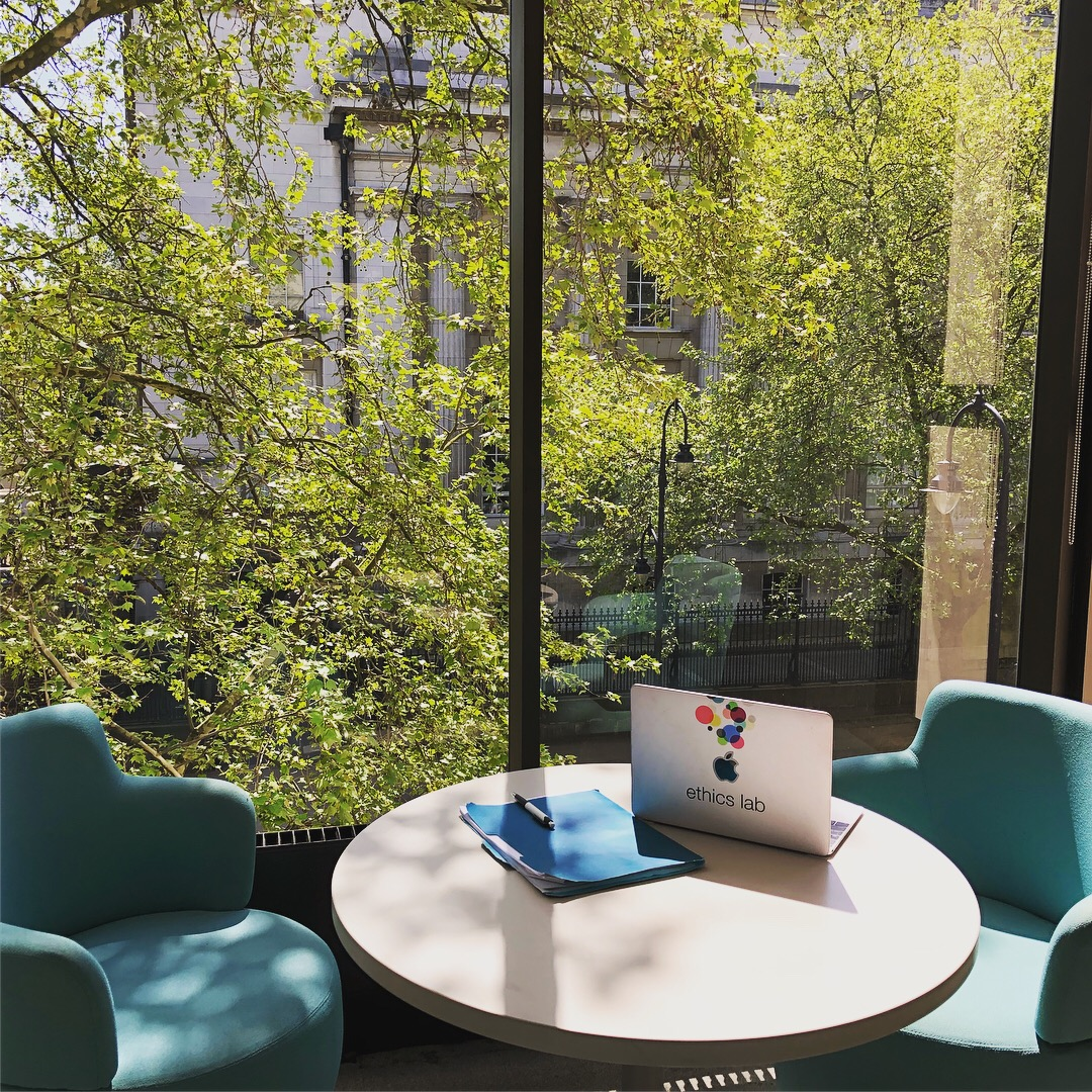 Comfy seating in front of a window overlooking the British Museum provides an idyllic workspace at the University of London's Institute of Philosophy.