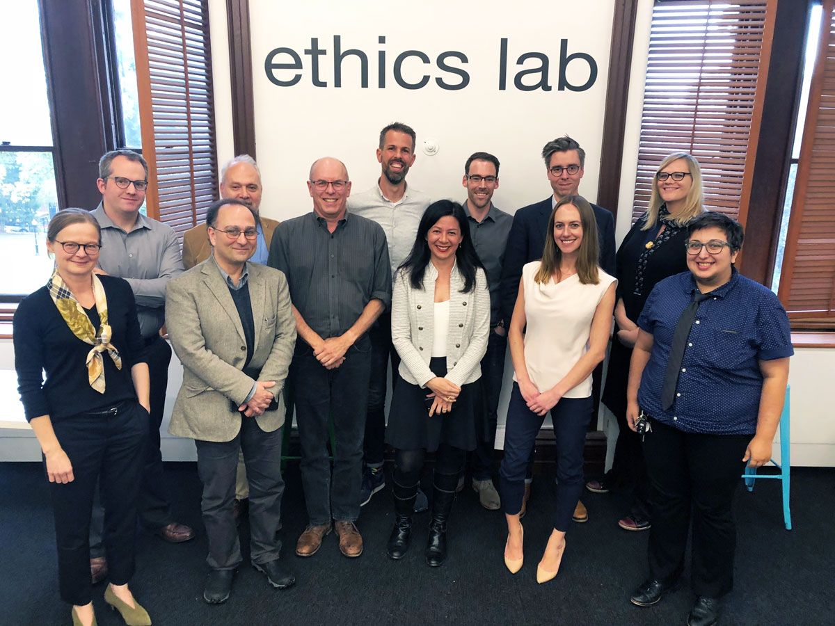Members of the Political Epistemology Network pose for a group photo in the Lab.