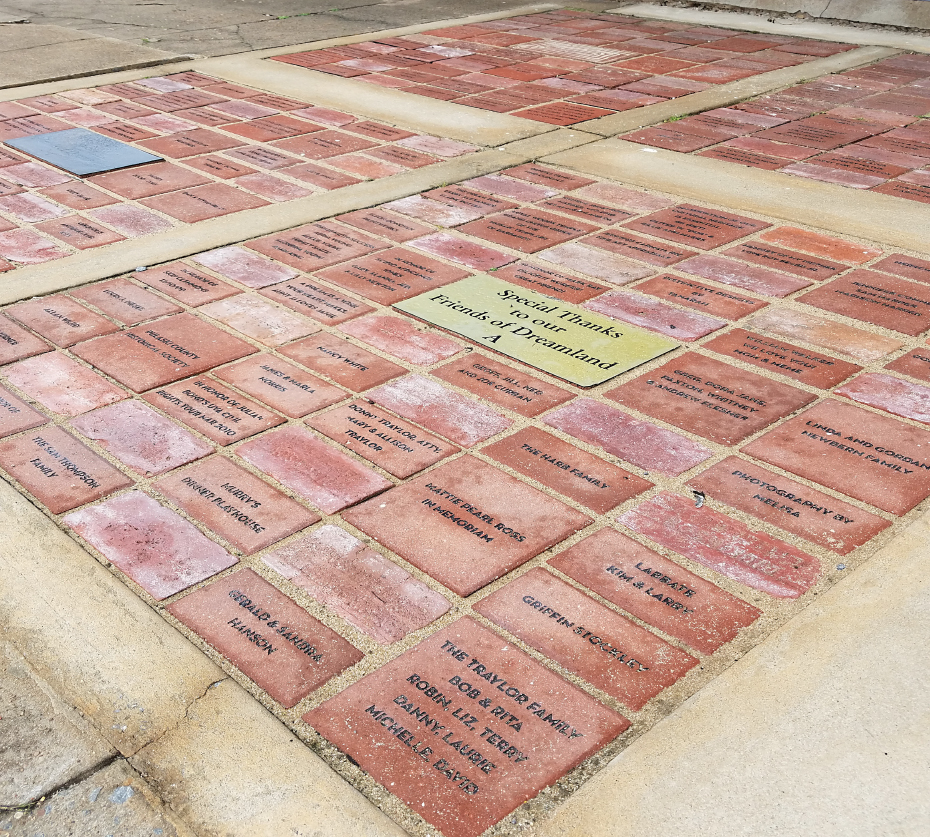 Bricks are set at the front door of Arkansas Flag and Banner and will wrap around the building.