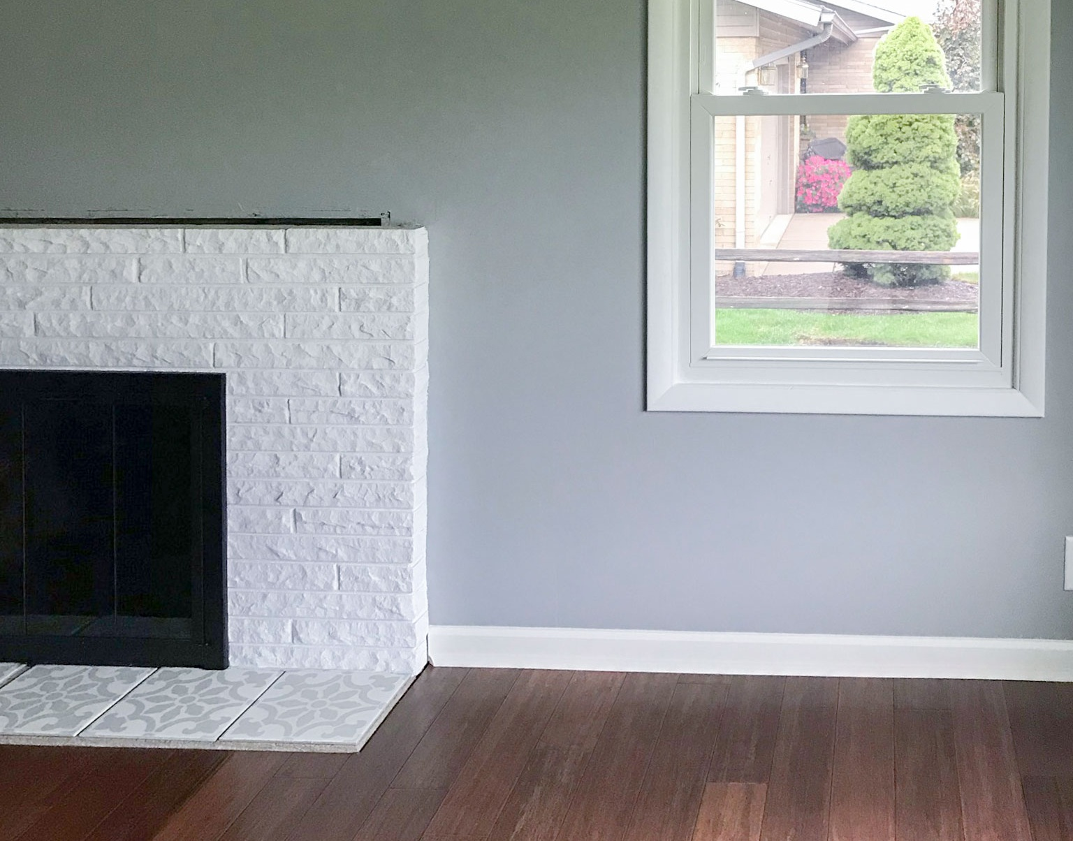 Before photo of a white fireplace inside a living room,
