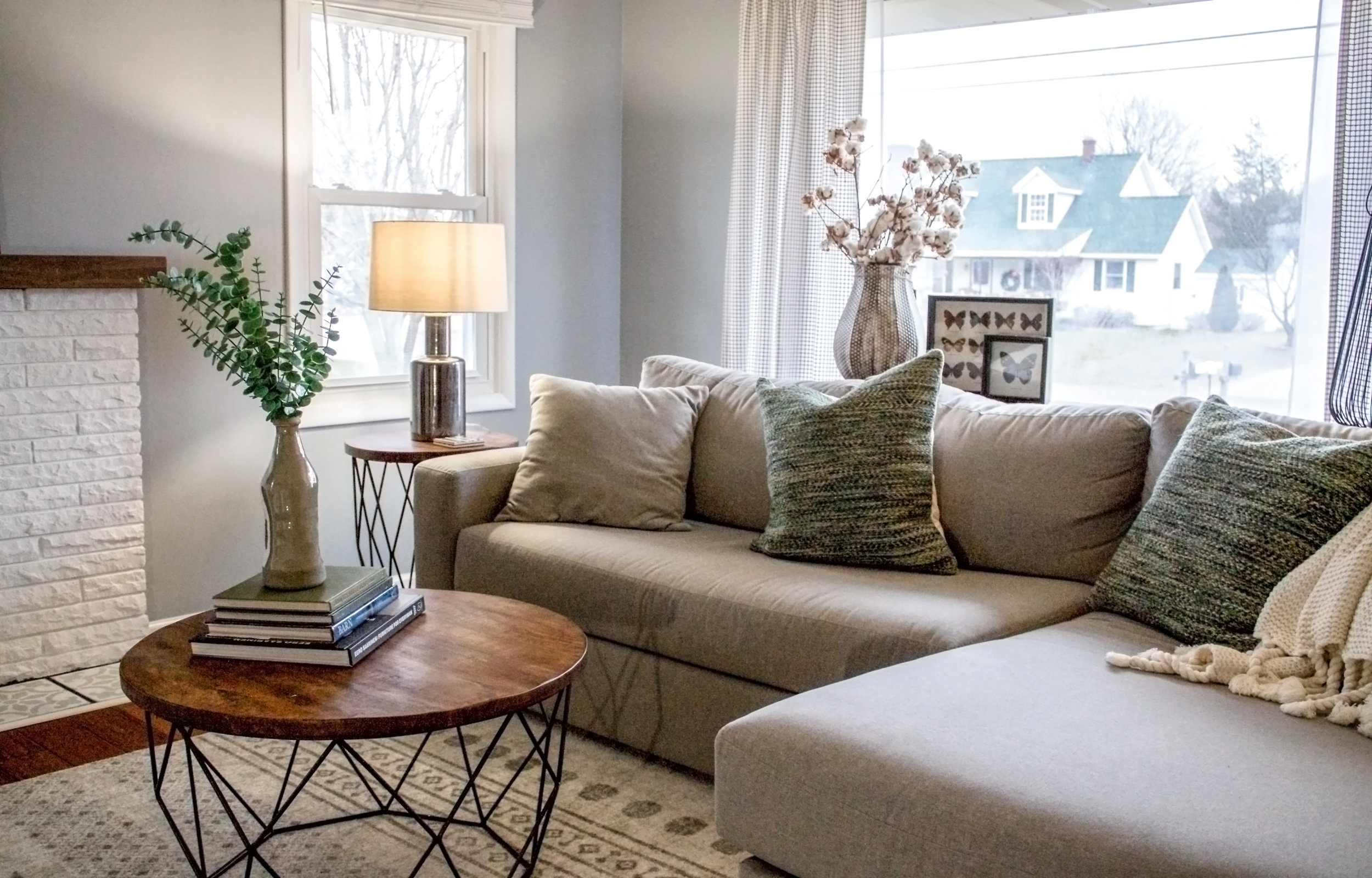 Younger sectional inside a trendy living room, living room designed by an online interior designer, abbreviated design provides online interior design services in Grand Rapids Michigan,