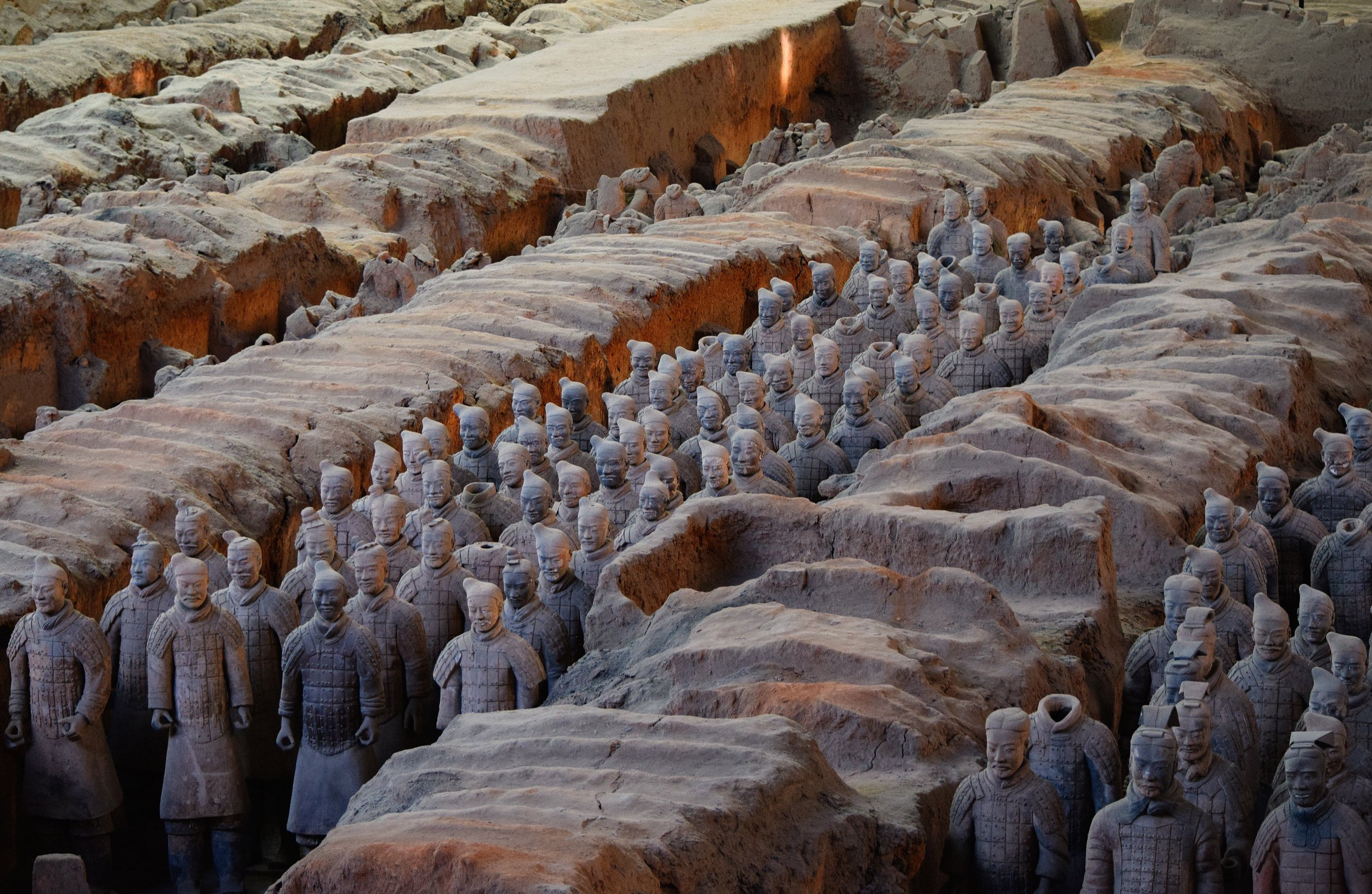 While digging wells on the outskirts of Xi'an in 1974, a group of farmers stumbled across one of the most significant discoveries in the history of archaeology; the terracotta army, which had remained hidden underground for over 2,000 years.    The site holds over 8,000 life sized clay soldiers, with each sculpture individualised so no two soldiers look the same. As well as model chariots and horses all buried with the mausoleum of the first emperor Qin Shi Huang; representing the army that triumphed over the other Chinese armies in the warring states period to form a united China.