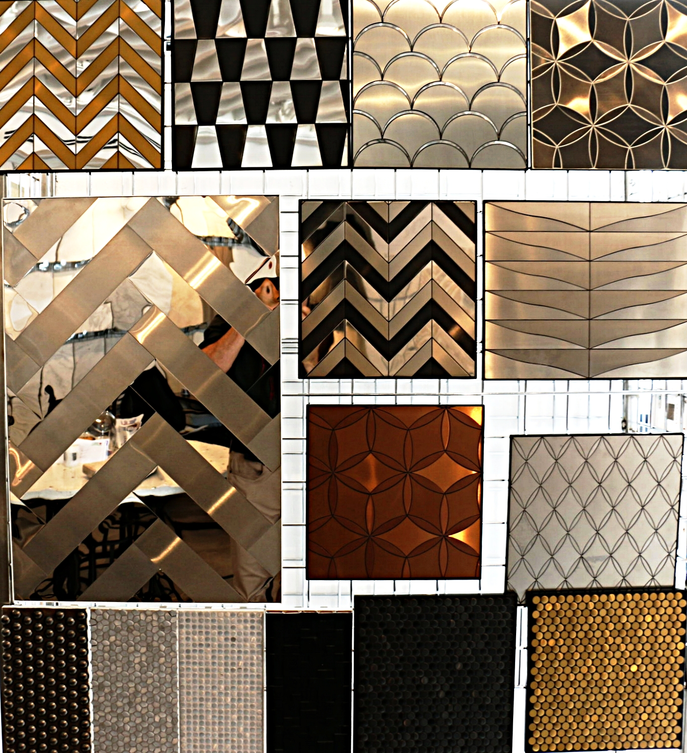 Metal tiles available in shiny and brushed finshes. Numerous patterns to choose from.