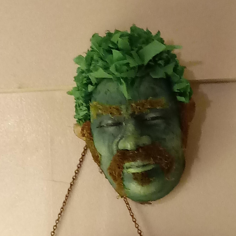 "Green Man , Lana Sheppard - 9"" x 5"" x 3"" - Paper and natural fiber - $30 starting bid"