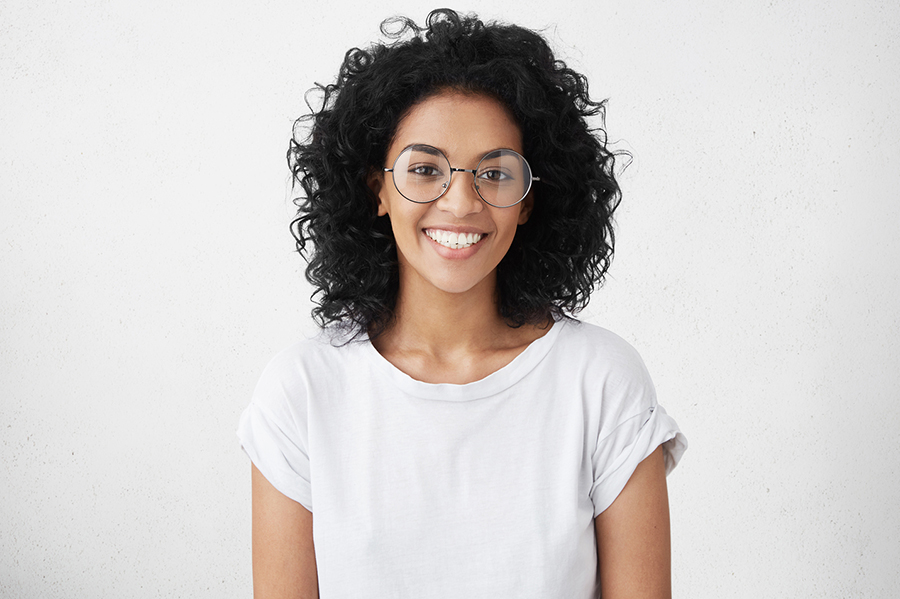 beautiful girl with curly hair smiling