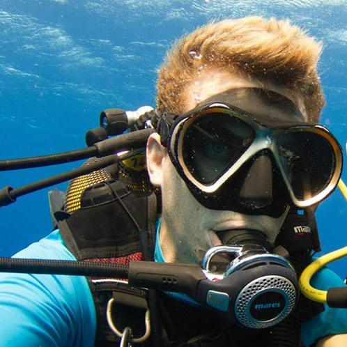 Baptiste Le Bouil   CMAS 3* INSTRUCTOR and SSI INSTRUCTOR   His passion and teaching skills made him a excellent underwater guide, whether it is with whales, sharks or just to ogle on corals. He will always find something interesting to show you.