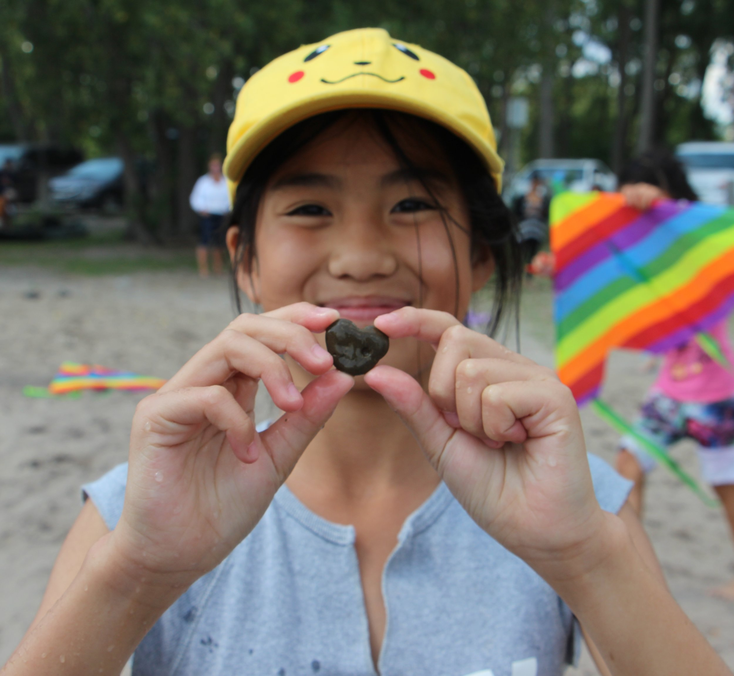 Nellie's_Child holding a stone that looks like a heart cropped.jpg