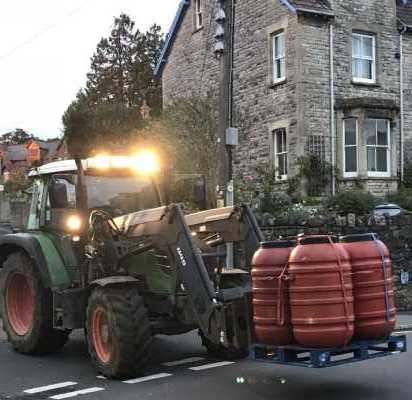 The tractor unloads the van.jpg