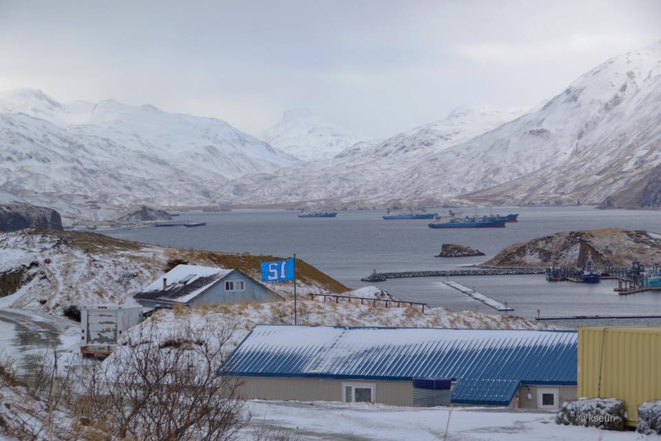 Raven House (12 flag) and Captains Bay beyond. To the left is Unalaska Island and right is Amaknak Island.