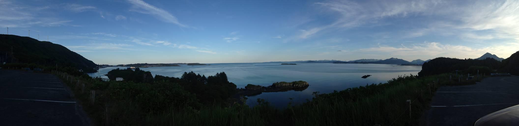View from Kodiak Island, Alaska; port of Kodiak on left (below wind turbines)