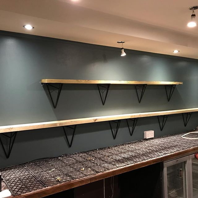 It's nice to finish a job on a Friday... at lunchtime. Installed these shelves today in the new gin bar I worked in last week. the wood was reclaimed from the previous decoration, I just planed it flat for them ready to refinish as they like. Fabricated more brackets, similar to some previously but altered slightly and an improved manufacturing process. Also, the painter has been in and started painting the walls I did, looking fantastic now!  #shelving #brackets #steel #madeinscotland #reclaimedwood #urbanchic #stylish #downlighting #gotoschoolonthefirstone #makersgonnamake #availableforwork #glasgow