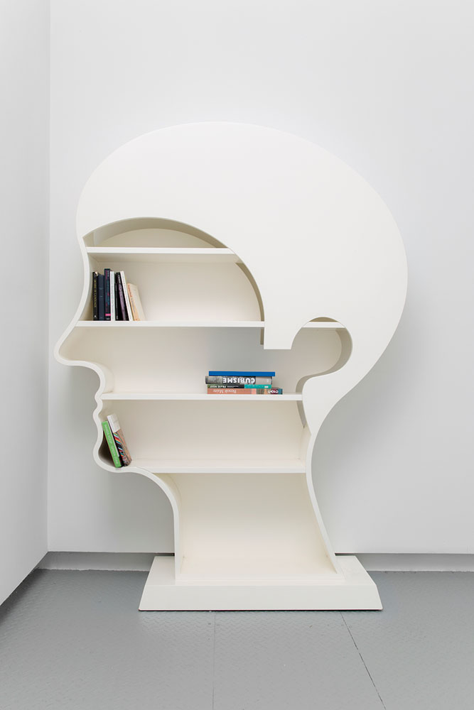 """Nicola L ,  Library Head , 1994, Lacquered wood, 64"""" x 84"""" x 12"""", Courtesy Estate of Nicola L / Elga Wimmer Gallery"""