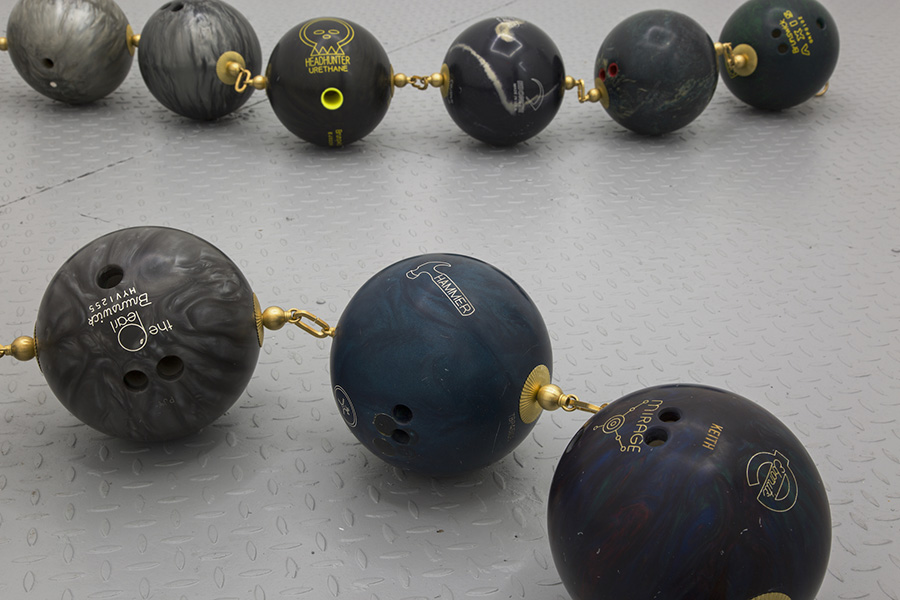 Barbed Wire,  2017, Bowling balls, brass, Dimensions variable (Detail)