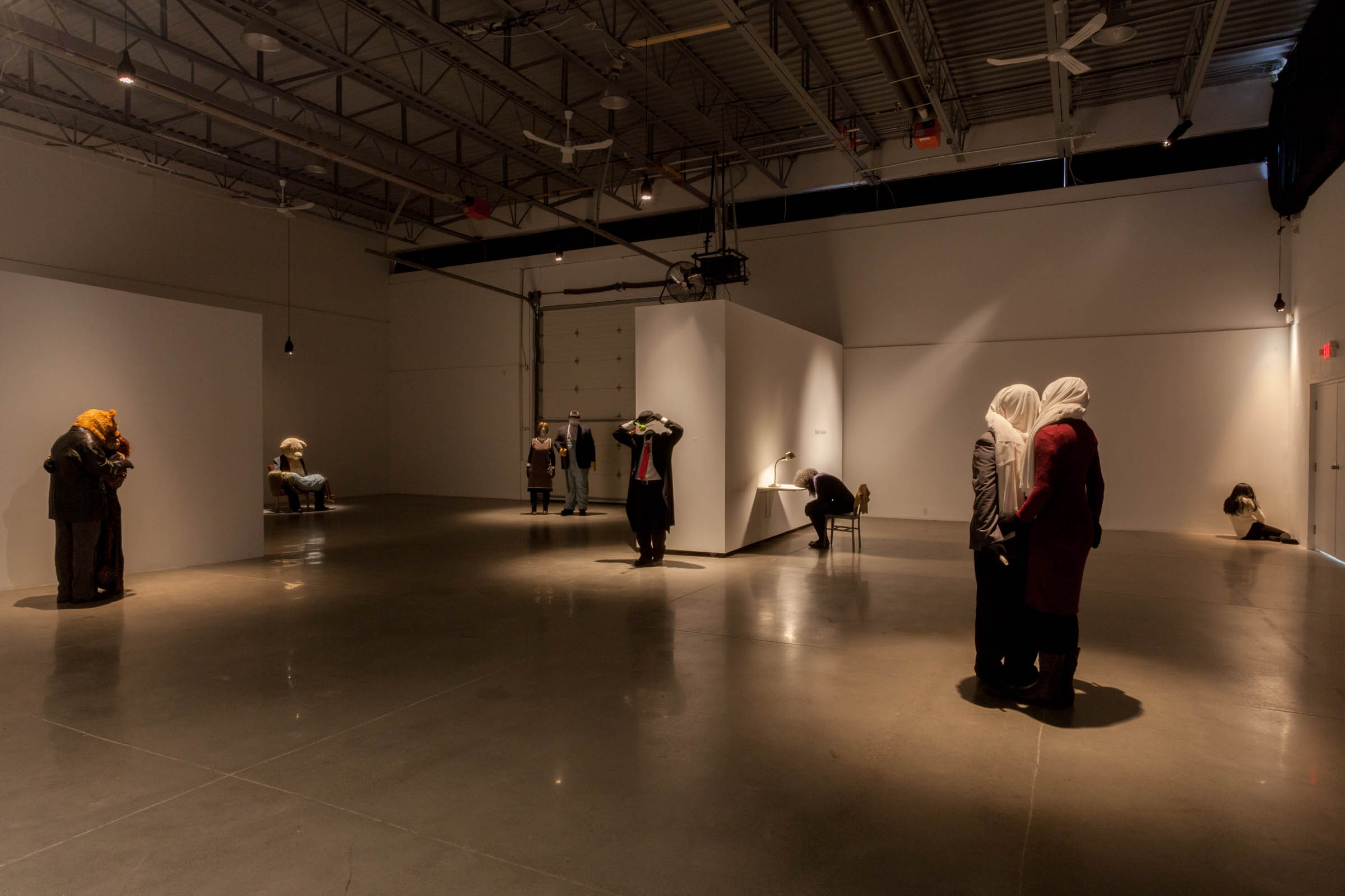 Mark Jenkins , Installation shot at Arsenal Contemporary Toronto, Foreground is  Below the Fold , 2016. Far right is  French Kiss , 2016, Top is  Suicide Bombers Atop a Skyscraper , 2016