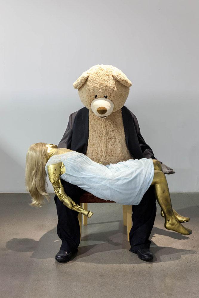 "Goredilocks and Papa Bear  , 2016, Plastic tape, fake hair, fabric, teddybear, concrete, chair, 56"" x 50"" x 40"""