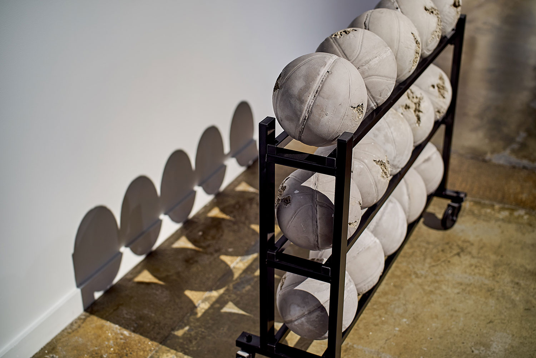 "Daniel Arsham ,  Glacial Rock Eroded Basketballs , 2014, Glacial rock dust, marble fragments, hydro stone, sand, display stand, 42 7/8"" x 49 1/4"" x 9 7/8"" (107 x 125 x 25 cm)"