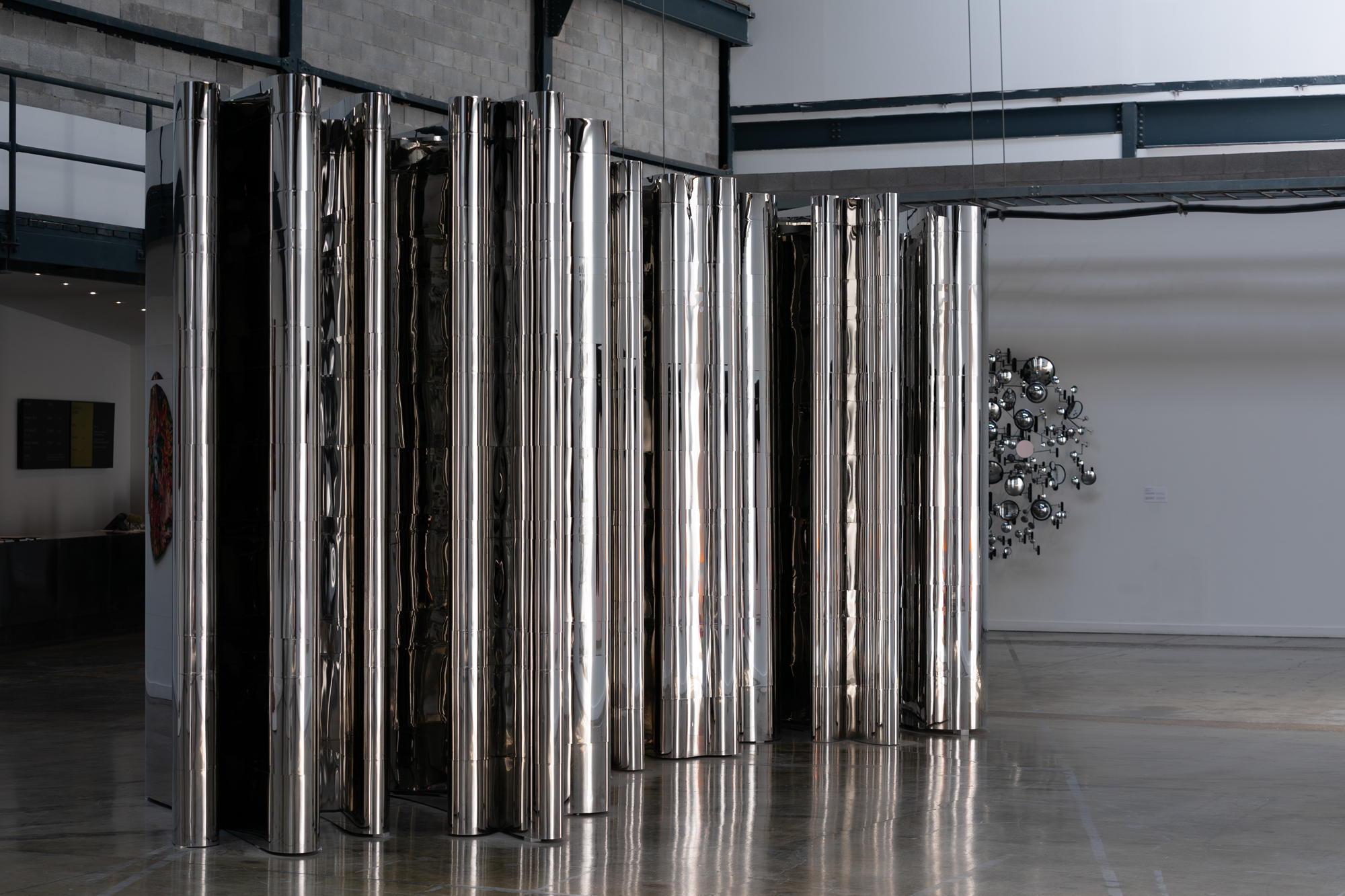 "Nicolas Baier ,  Eternity , 2014, Stainless steel, 118"" x 300"" x 102"" (300 x 760 x 260 cm). Photo credit: David Wong"