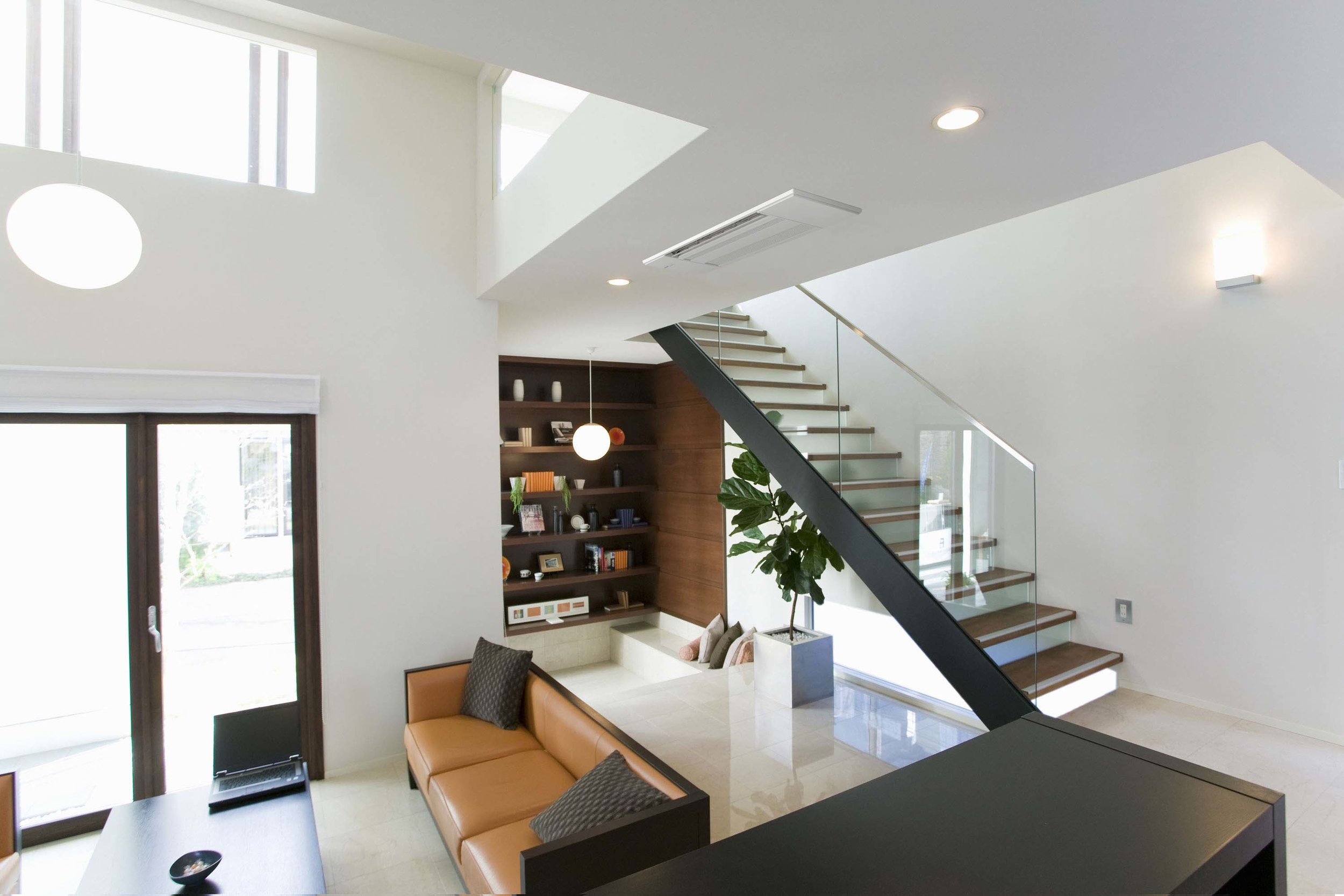 MLZ+Living+Room+with+Staircase+Lifestyle.jpg