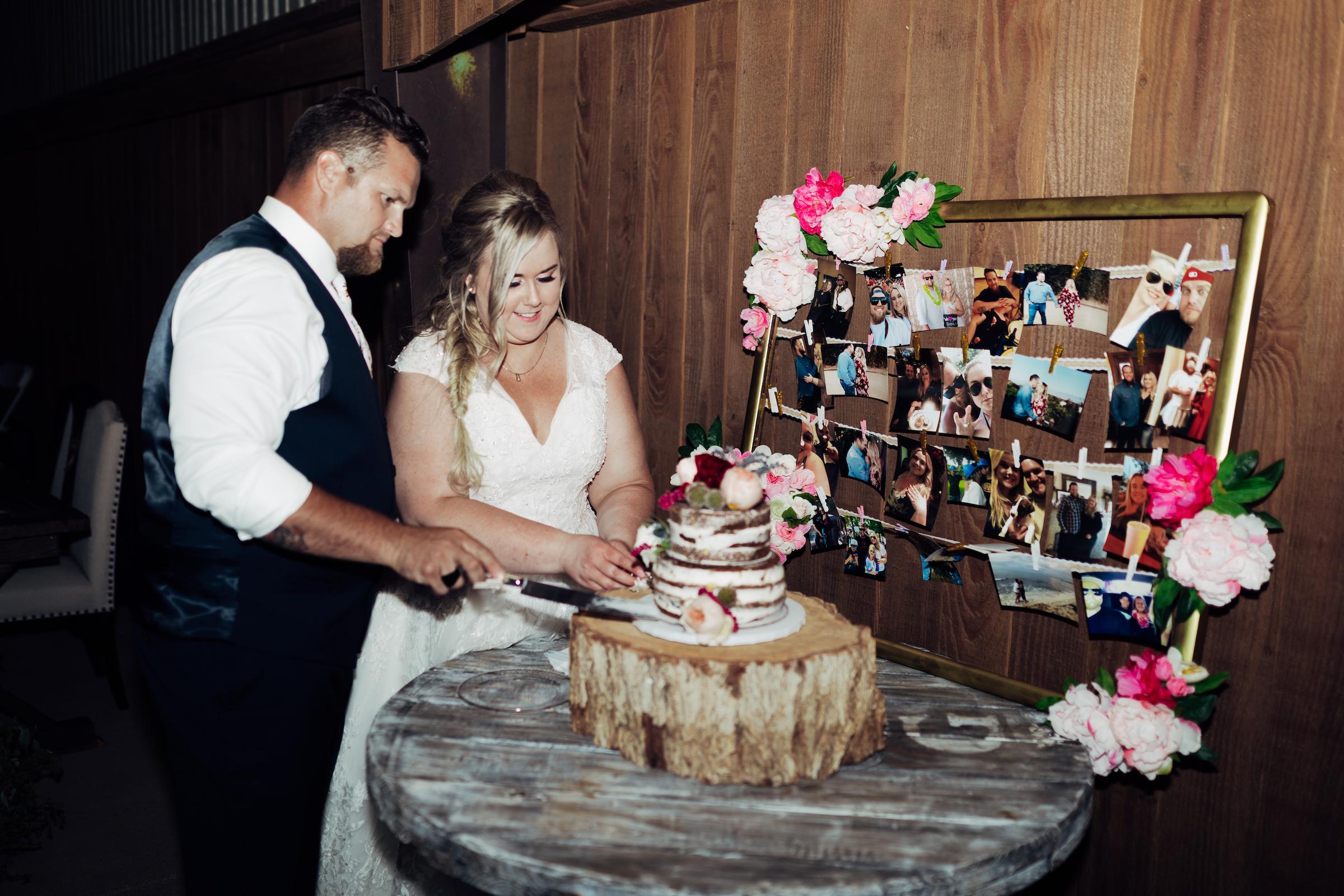 Catie & Andrew Cut Cake .jpg