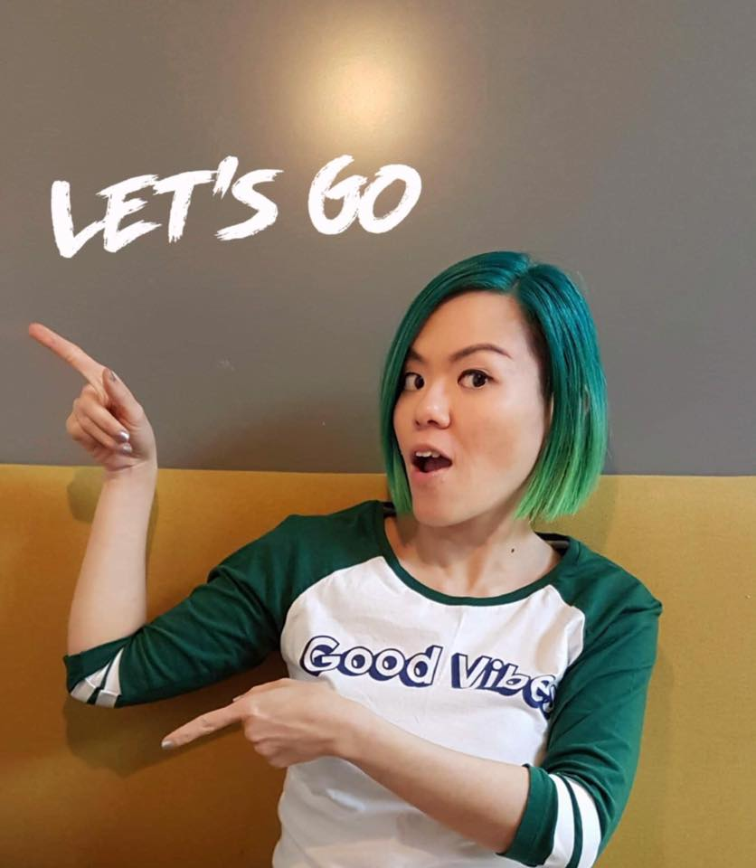 """Penny Soo pointing to the wall that says """"Let's go"""""""