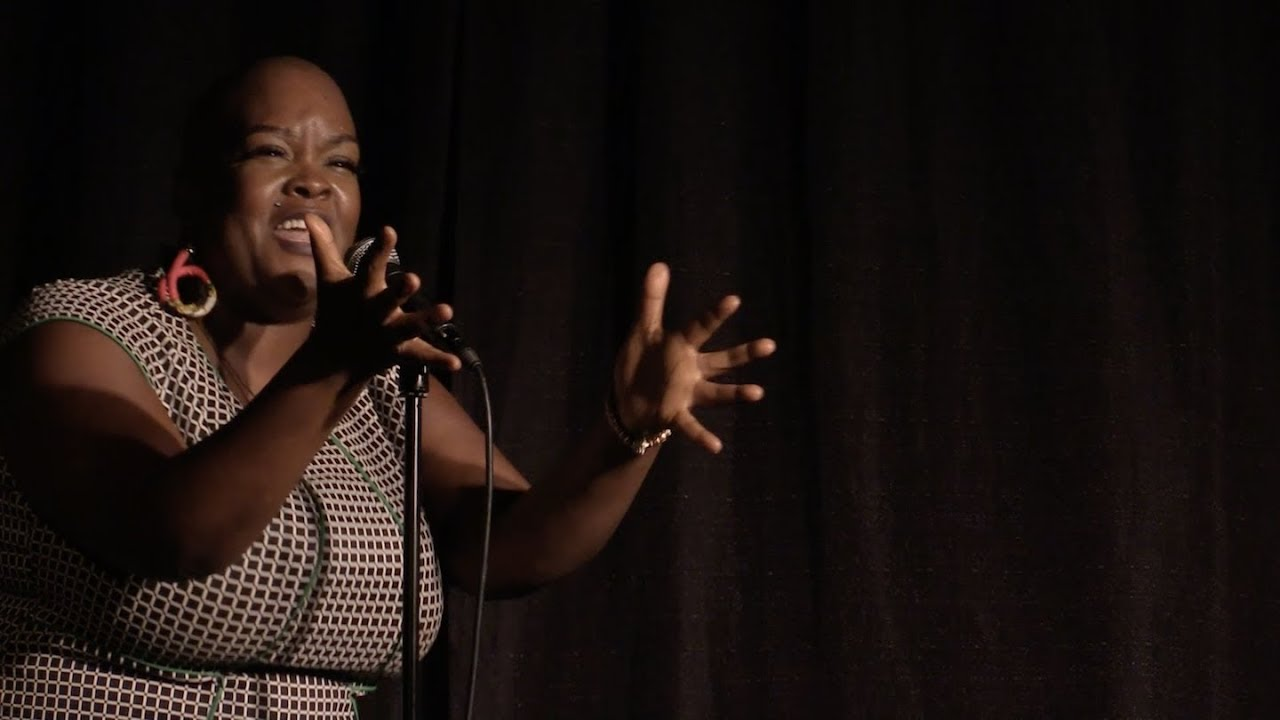 "Sonya Renee Taylor, performing at Button Poetry Live, April 2018. Reading ""The Body Is Not An Apology"" -  https://www.youtube.com/watch?v=iXLSKHzOLkA"