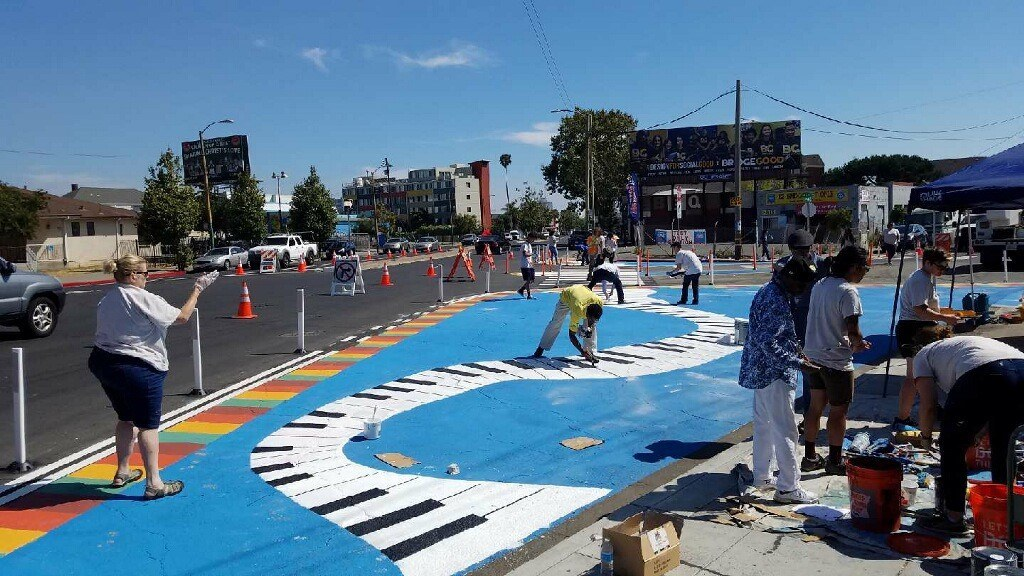 Paint the Town mural in partnership with the City of Oakland. Residents and SPARC partners worked to re-designed a dangerous intersection by transforming the street into a music-themed plaza area.