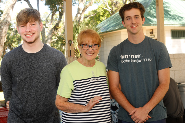 L-R Stephen DeMaria of Flagler Palm Coast High School, who will be going to Daytona State College and majoring in Photography, Ann DeLucia, President and Mario Saponaro of Matanzas High School, who will be going to Stetson University to study illustration.