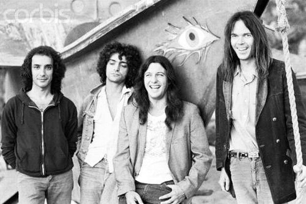 NEIL - … por Neil Young con Come On Baby Let's Go Downtown, del excelente disco de estudio Tonight's The Night, publicado en 1975. La canción misma fue grabada en directo en el Fillmore East de Nueva York en 1970 con Danny Whitten de la banda Crazy Horse a la voz y guitarra. Este muere de una sobredosis en 1972. Muy afectado, Neil Young le dedicará el álbum Tonight's The Night.