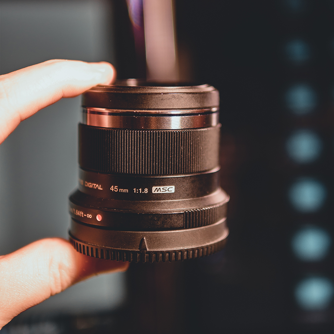 Olympus 45mm f1.8 - This is a cracking portrait lens, and it is also one of my favourite things: CHEAP! It's small (so small I have almost lost it a few times to be honest.) The results are stunning.