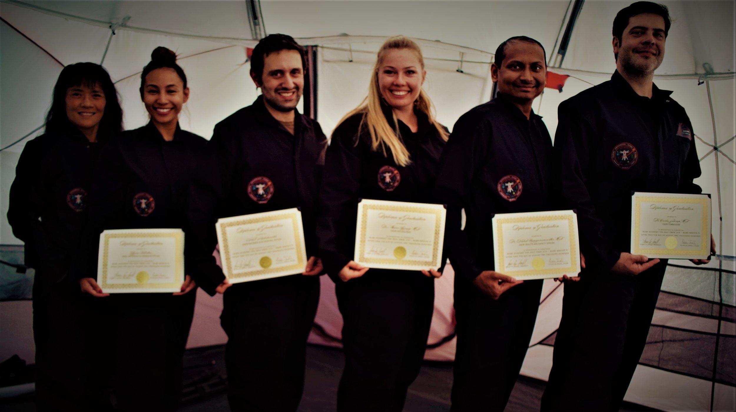 MAU Crew 1115 - Mars Medics II: Graduation Day at end of a successful training mission. Crew receiving their Graduation Diplomas