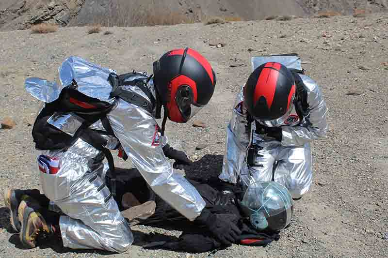 MEVA team evaluating downed astronaut.jpg