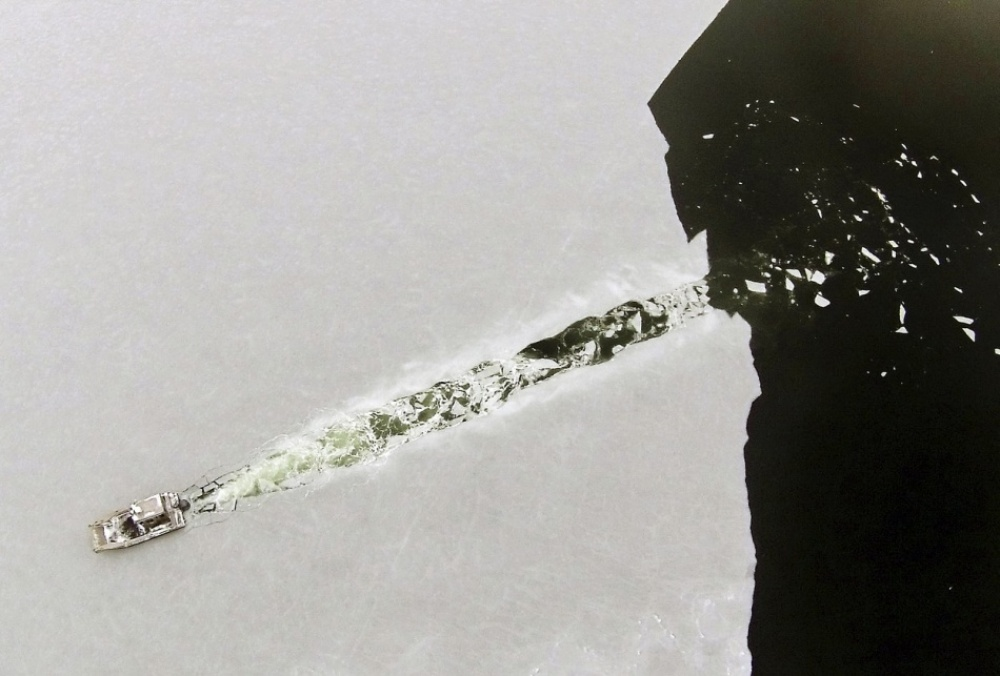 boat cuts through ice by Peter Periera.jpg