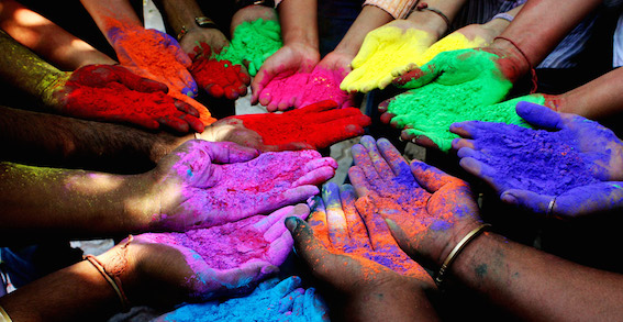 People-holding-powder-paints-to-celebrate-Holi-Festival-of-Colors-in-Ahmedabad-India copy.jpg