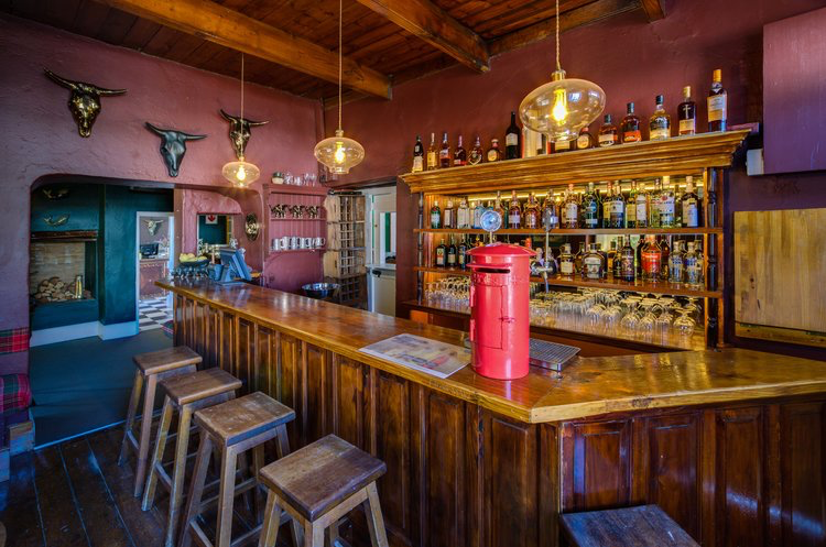 The pub pays homage to its roots with a vintage post box proudly perched on the counter.
