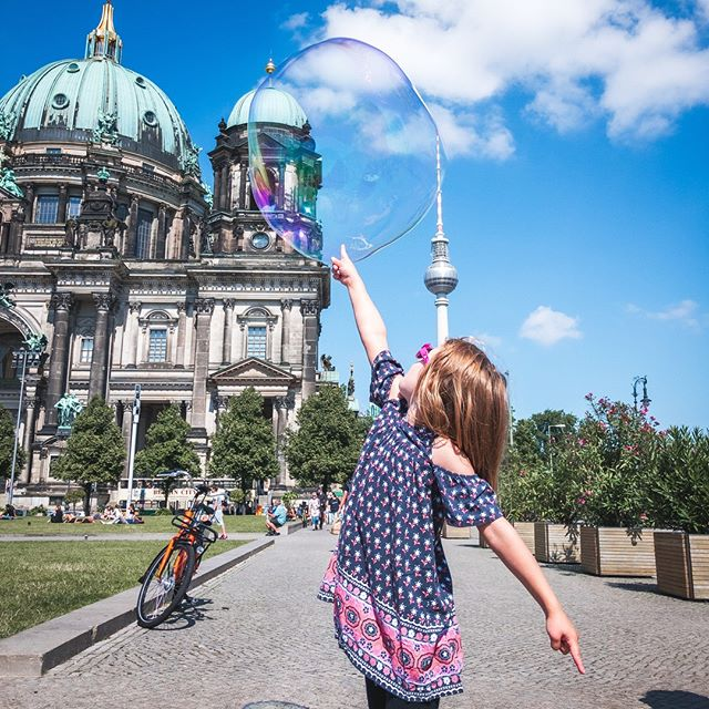 A perfect capture of a glorious moment! Found the @bubblebrothers.eu at the @berliner_dom and spent a good hour here playing with bubbles. Ended up buying a set of bubble sticks and have been carrying them all over Europe. The things we do for our kids! #lookatthosepointedfingers #popthatbubble  __________________________________________________________________________________________________________________#bubblebrothers #berlinbubbles #kidslovebubbles #bubble #berlinerdom #visitberlin #berlinwithkids #goberlin #familytravel #travelfamily #kidsthattravel #kidswhoexplore #kidexplorer #girlswhotravel #loveit❤ #travelwithus #30daylocals #familyadventures #familyholidays #travelbloggers #travelblogging #travelbloggerlife #perfectcapture #travelmoments #traveltogether #travelmom #seetheworldwithme #berlintvtower