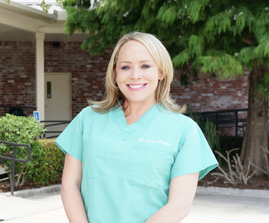 Dr. Erica Capshaw Brooks   After growing up in New Orleans and graduating from the Academy of the Sacred Heart, Dr. Erica attended Louisiana State University and received her Bachelor of Science degree in animal science.