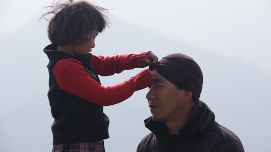 "Tashi shares a tender moment with Lobsang Phunstok.  HBO/""Tashi and The Monk"""