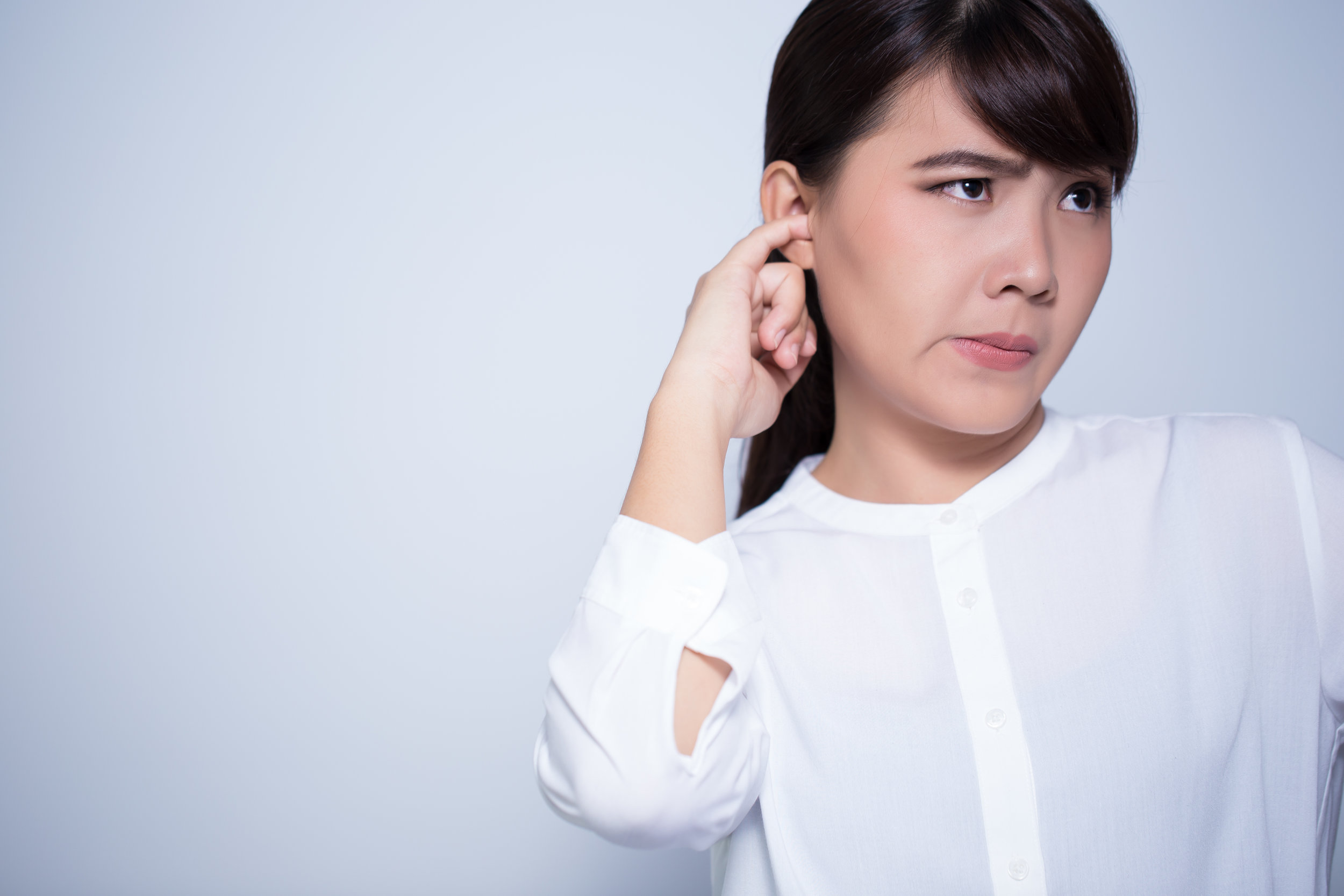 Woman is picking his ear