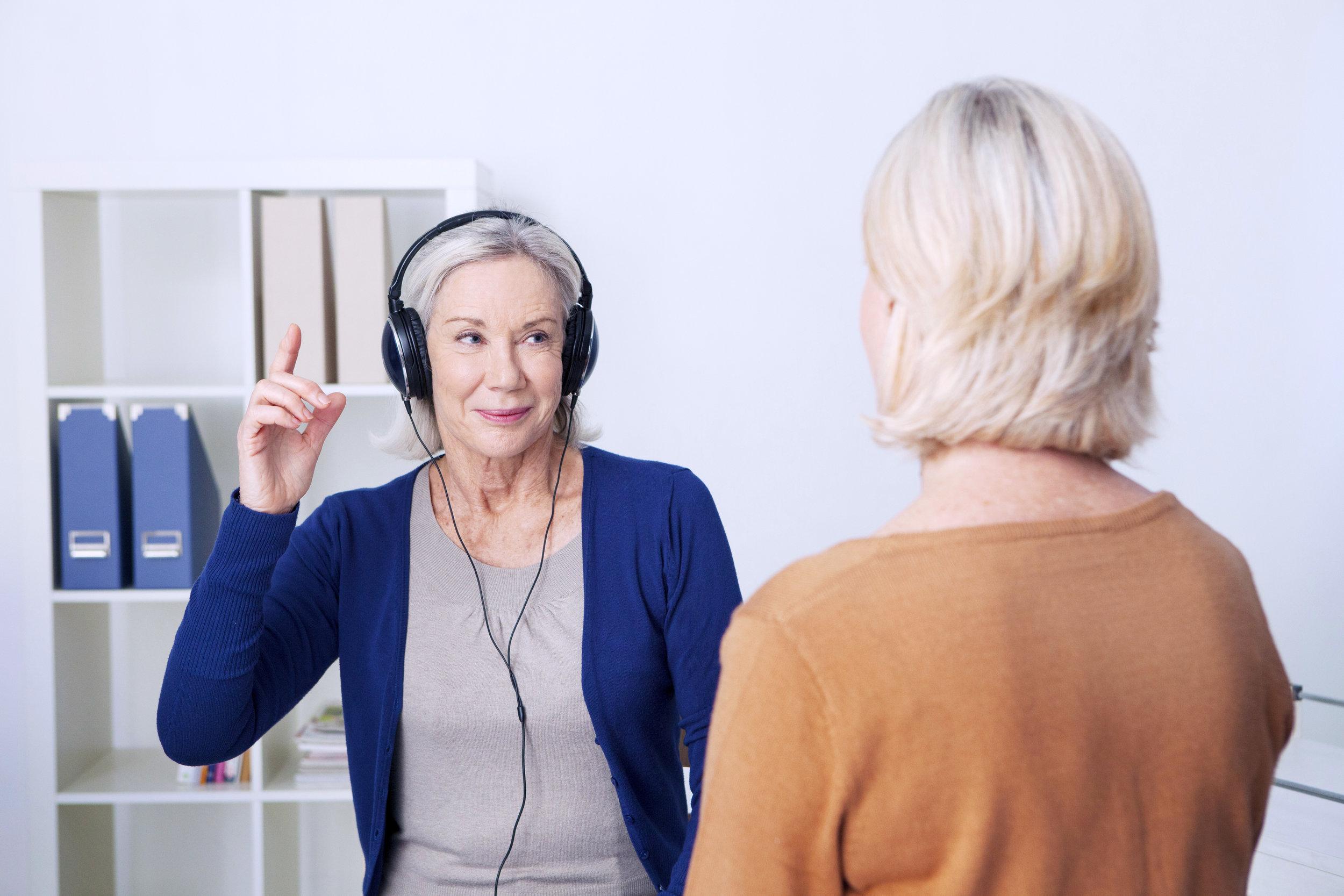 Senior woman undergoing a hearing test