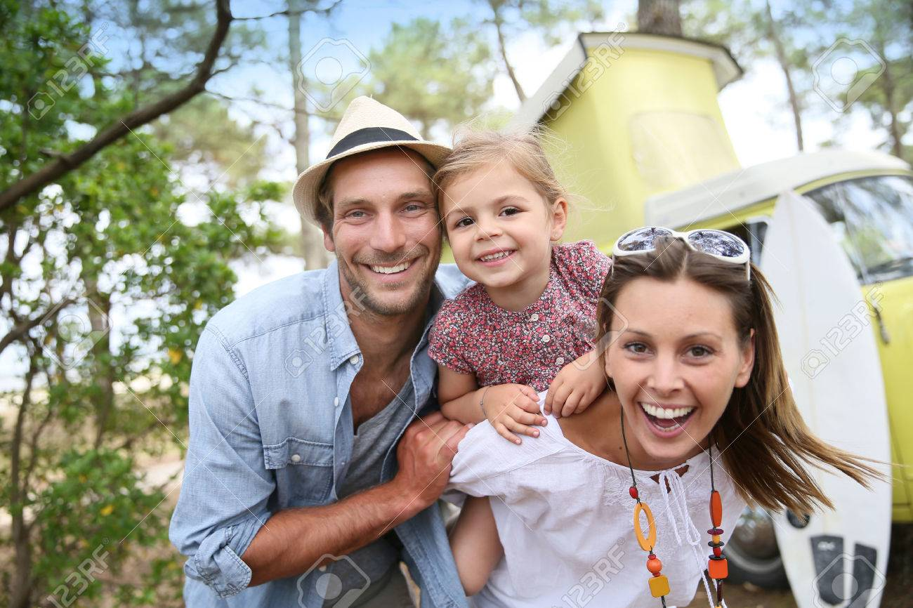 41809765-couple-with-little-girl-enjoying-vacation-in-camper-van-Stock-Photo.jpg