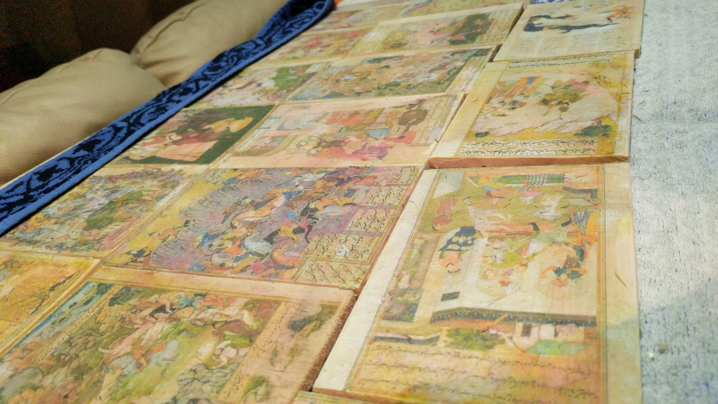 "Historical Illustrations transferred onto wood slats to be hidden in the ""archaeological site"""