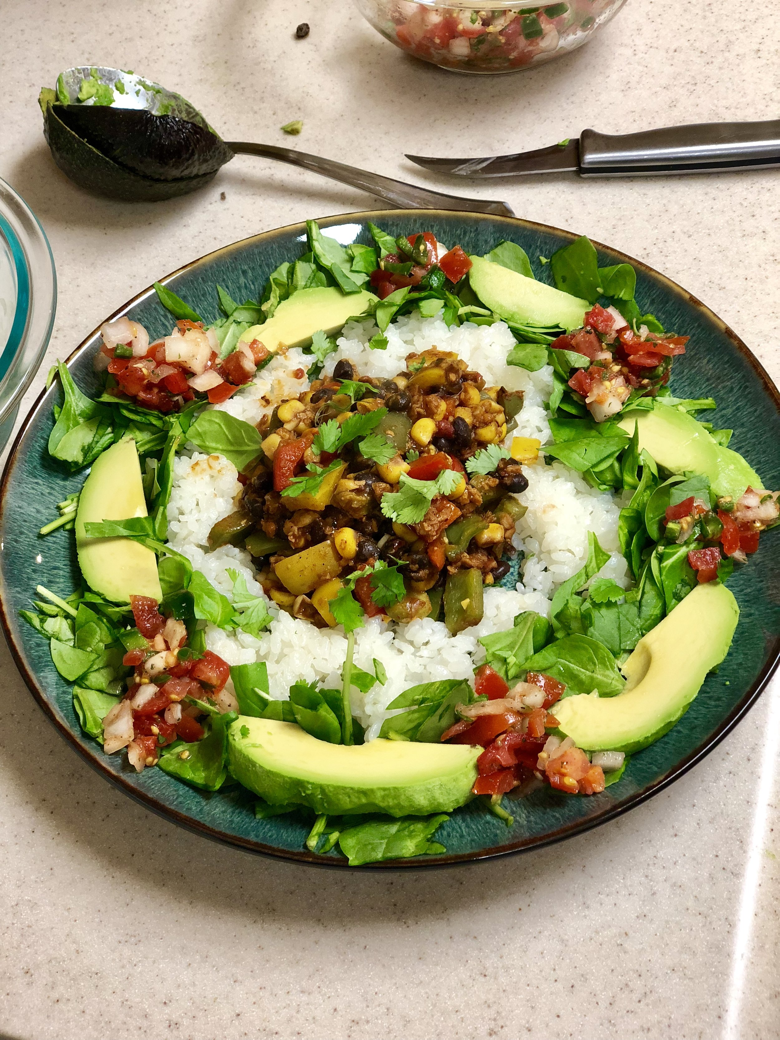 Naked Burritos   - (Makes 4 servings with leftovers)Ingredients: Two cups of walnuts chopped up smallRice  Avocados A bag go your favorite lettuce mine is spinach,  arugula, or kaleI package of Soyrizo 3 bell peppers of various colors1/2 chopped of an onion16oz (1 can ) of red beans 16oz (1 can )of black beans 11oz (1can) of Mexicorn Tablespoon of oil in the panTablespoon of lemon juice in the panTablespoon of Siracha  in the pan1/2 tablespoon of dried cilantroHalf a teaspoon of paprika 1 Tablespoon of minced garlic1/2 of a red onion chopped1 teaspoon of chili powder1 teaspoon of oregano1 teaspoon of cuminA dash of salt1/2 a teaspoon of pepper Directions:Place the oil, lemon, Sriracha, Cilantro, Paprika, Garlic, Chili Pepper, Cumin, Oregano  Salt, and Pepper in the pan on medium heat. Once those ingredients start sizzling add the onion, bell peppers, walnuts, beans, soyrizo, and corn. Cook the ingredients on low until the veggies are to your liking. While your veggies are cooking throw two cups of rice into the rice cooker. When everything is cooked, it is your turn to dress up your burrito any way you like and get creative. I add avocado, home made pico de Gallo, and fresh cilantro.
