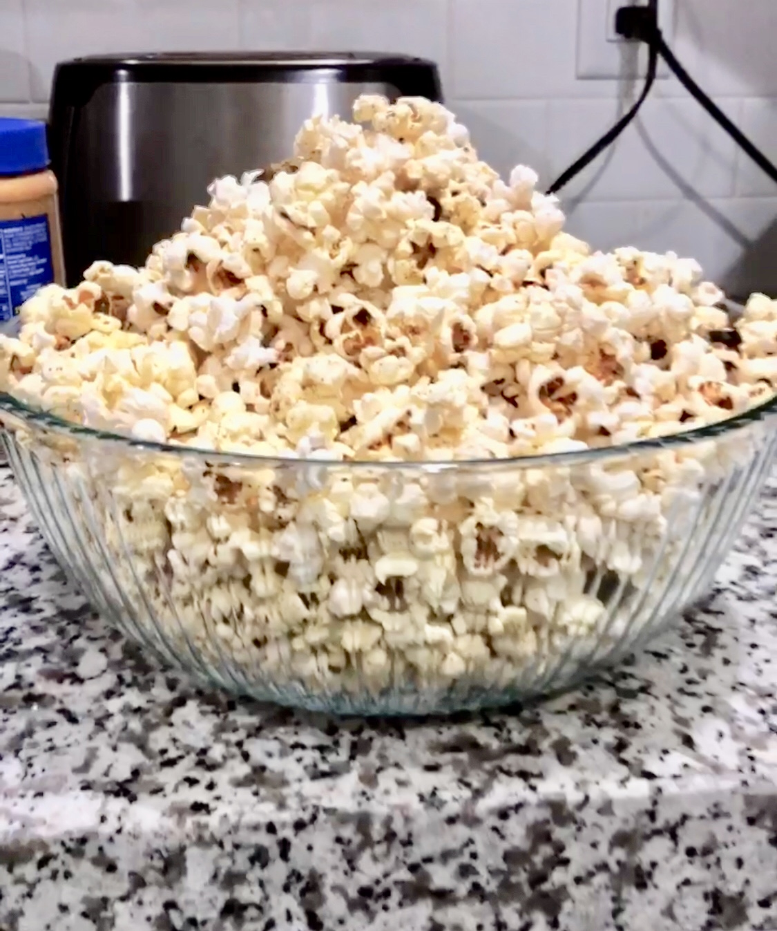 Jalepéno Popcorn - 1 1/2 cups of yellow popcorn kernels1/2 teaspoon of Lowry's  seasoned salt1/4  teaspoon of garlic powder1/8 teaspoon of paprika1 cup of jalapeños from a jarVegetable oil Directions:Place some oil and the jalapeños in a big pot and fry them till they start to turn a little brown. Once the jalapeños are browning add the rest of the ingredients and mix it all around. The oil should be enough to cover half of the kernels. As the popcorn pops move the pot around to keep the kernels moving so it doesn't burn. This makes a lot of popcorn so it's perfect for a movie night with friends or family!