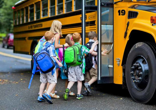 kids-getting-on-the-school-bus-small-2-600x422.jpg