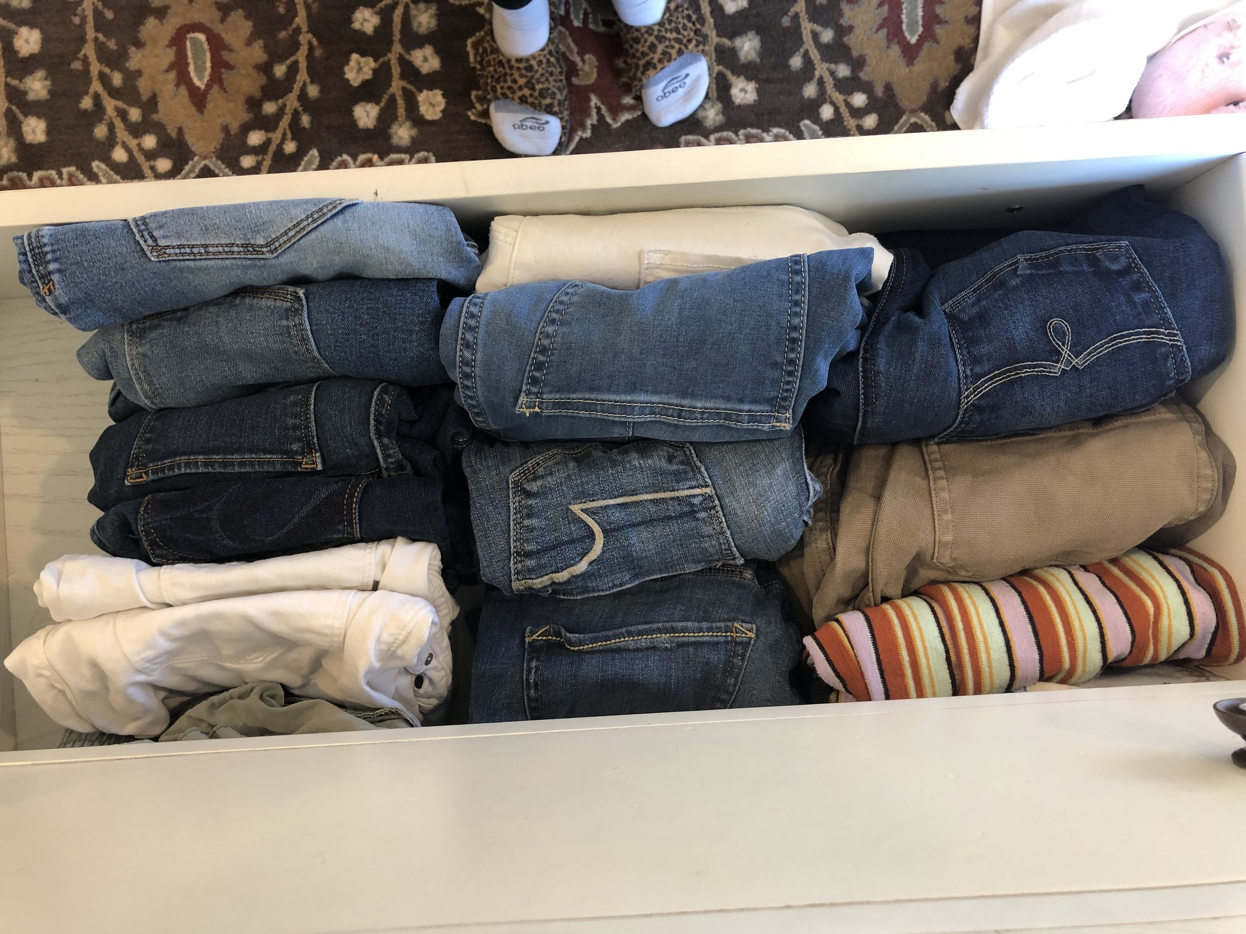 This is a pants drawer from above, and also my feet! They keep photobombing me!