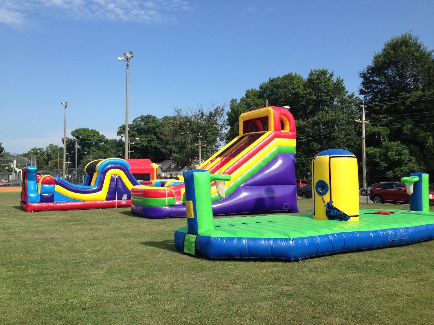 From back to front: Bounce house, obstacle course, 18 foot slide, sports challenge bungee run.