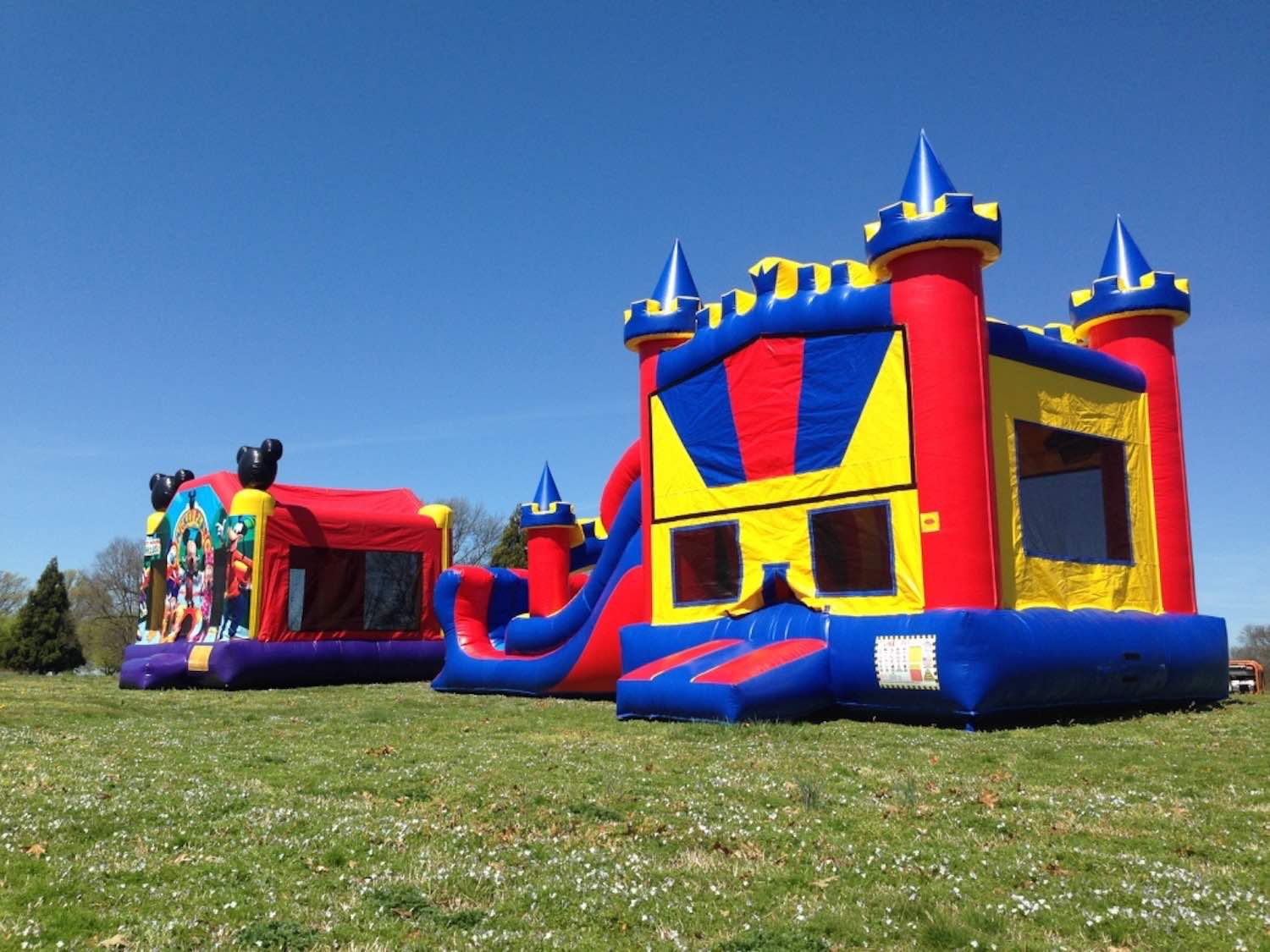 Kings Castle Combo and Mickey Fun Park bounce house.