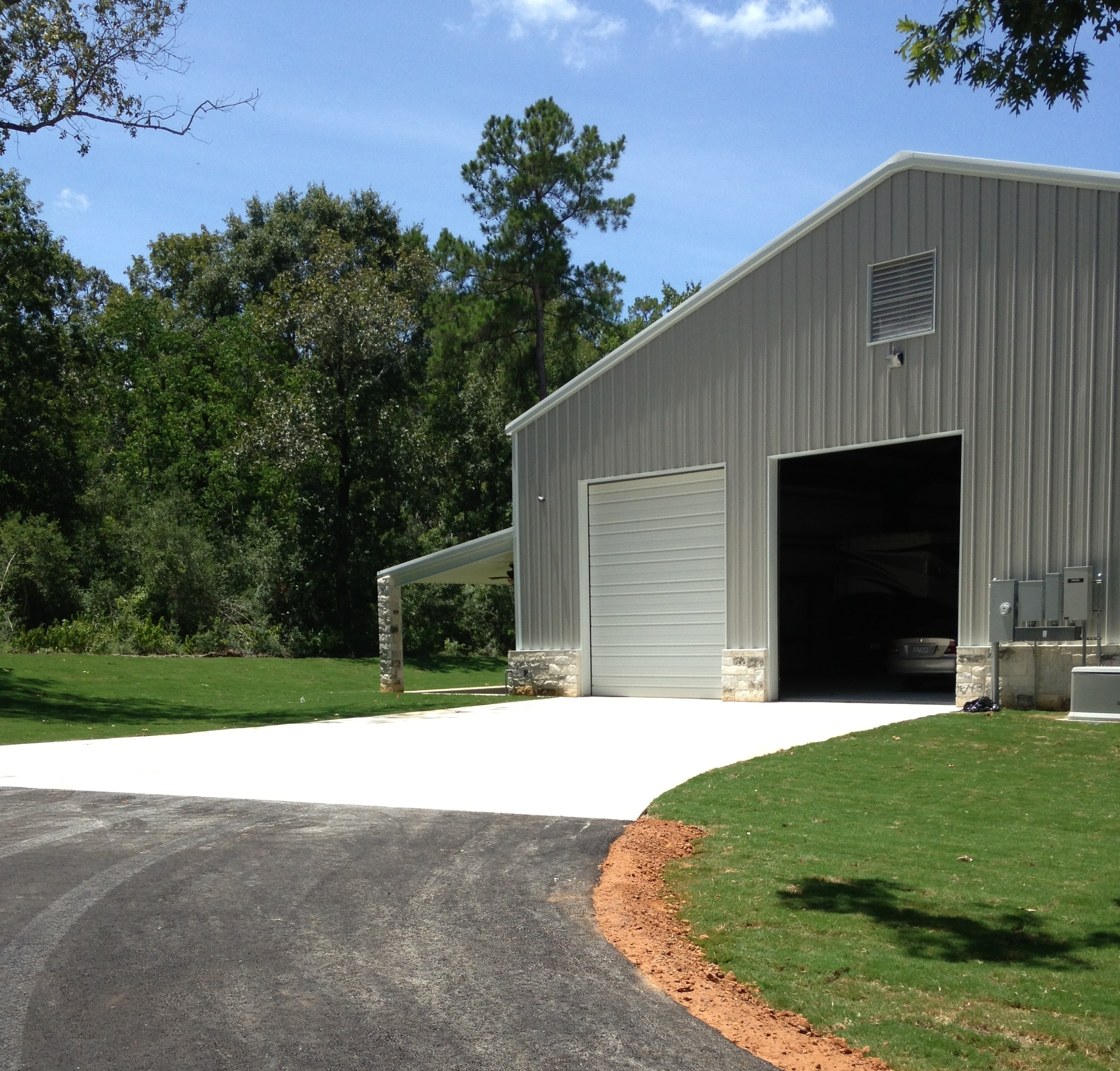 Driveways - We do both Commercial & Residential driveways.(Image: Half-concrete & half-asphalt driveway)