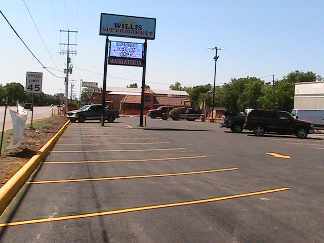 Parking Lots - (Image: Brand new parking lot at Willis Supermarket)
