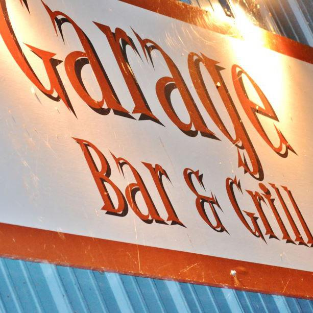 Garage Bar & Grill - BBQ & bar eats are served at this pared-down watering hole with garage doors & a dog-friendly patio.(231) 386-5511